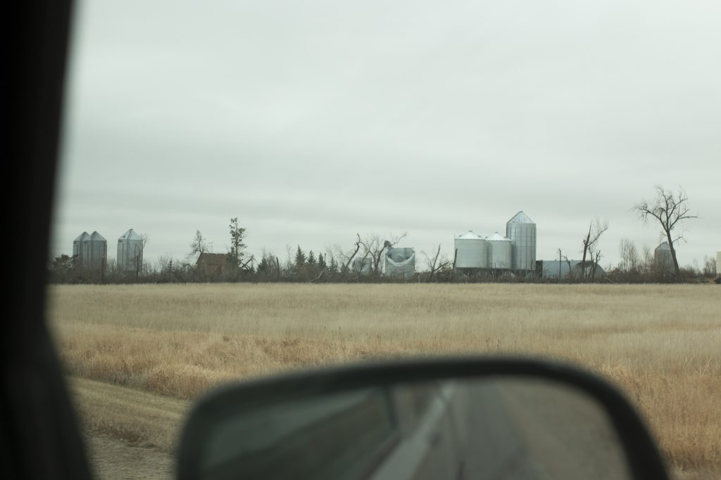 View of a Prairie farm outside a truck window
